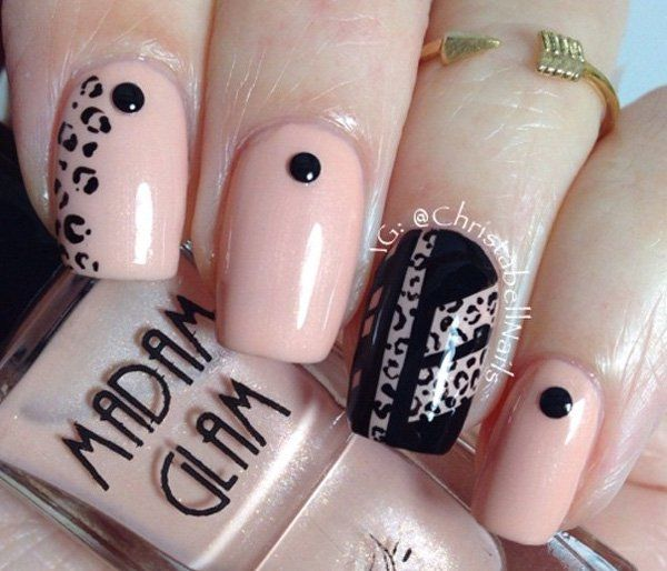 Nude color and black with leopard nail art
