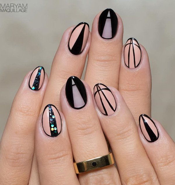 Nude color and black nail art
