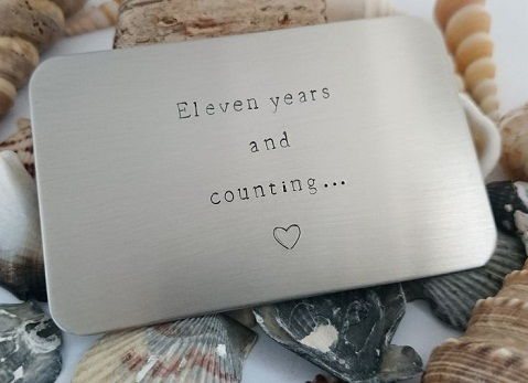 Get this custom wallet insert made just for your 11th anniversary gift. The wallet insert is a card shaped steel piece that is engraved with loving words.